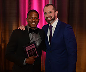 A photo of Aaron Wesley and colleague at the 2017 CMR Leadership Awards.