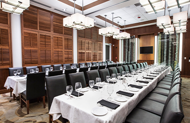 Empty private dining room with two long tables and chairs