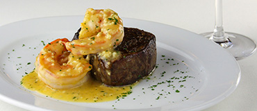 A filet topped with shrimp