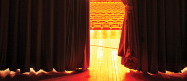 A stage and red curtain