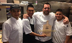 Executive Chef Adam Polisei and team