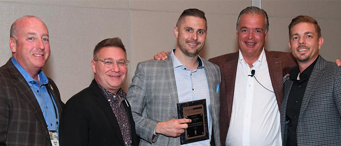associates with award at the 2019 CMR leadership conference